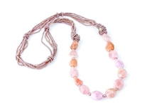Rajola's long Forever Necklace done in multi-strands of Pink Pearls & Morganite Gemstones. The soft hues of this Designer piece make it the perfect Neutral to wear with most any color.