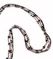 Long 3 strand Black Onyx Necklace filled with movement & visual interest. Each strand features different shapes & sizes of Onyx, Red Coral & Hematite Gemstones, sure to catch your eye. Made in Italy by Rajola. Fits over the head, no latch. Length 38""