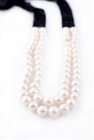 This designer Necklace by Rajola is one you will wear for many years. The large, double strand of White Pearls have a unique look with faceted Black Onyx Gemstones that have been woven into a band and attached on an 18k Gold Bar. No clasp. Length 32""