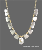 "Lustrous, large (1""L x 3/4""W) Baroque Pearl is enhanced on both sides with large, brushed gold, Fan shaped beads and Gold Filled Stardust Beads. Hand crafted by Silver Pansy and finished on Gold Filled Chain. Hook Closure, adjustable in Length 20"" to 15"""