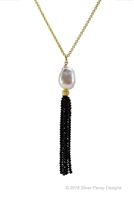 "Beautiful Tassel Necklace will never go out of style. From a single White Mabe Pearl descends a Tassel of Black Spinel Gemstones. Wear with a ""T"" or little Black Dress. Made in the U.S. by Silver Pansy. 24"" Gold Filled Sterling chain,Tassel length 2 1/2"""
