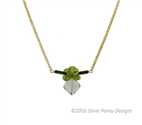 "Dark Green Tourmaline make the bar that holds a cluster of Green Peridot Gemstones and a diamond set drop of soft Green Praisiolite. Hand crafted in the U.S. by Silver Pansy. Gold Filled Wheat Chain 17-18 inch length. Pendant 1 1/4' wide, 1"" long."