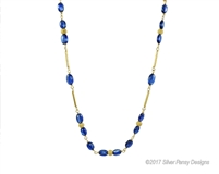 Enjoy the richness of Blue Kyanite in this lovely Beaded Necklace. Complimented by the warmth of Gold Filled Stardust Beads and Chain. Hand crafted in the U.S. by Silver Pansy. 6mm wide,19 1/2 inches in length, Lobster Clasp.