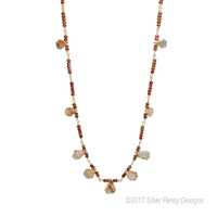 "Free-form tear drop shaped Copper Rutilated Quartz Gemstones are complimented by Hessonite (Cinnamon) Garnet. Hand crafted in the U.S. by Silver Pansy. Gold Filled Chain links, 20 inch in length, Lobster Clasp. Tear Drops 1/2"" to 5/8""."