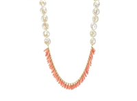 Unique in design, this limited edition Coral & Pearl Necklace is by Silver Pansy. Peach Coral Beads are fringed in the front with large White Freshwater Coin Pearls (13-14mm) accenting the sides. Gold Filled chain and clasp. Made in the U.S. Length 19""