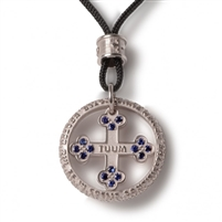 "Tuum's best expression of their passion for craftsmanship can be found in the Pendant version of FLORE-symbol of life, in White Rhodium sterling, Sapphire gemstones, and the micro sculpture Latin relief of ""Pater Noster"" (Lords Prayer) on the outer ring"