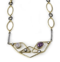 "Made in Turkey, by Tekhe Jewelry.Two-tone Gold plated and Black Sterling Silver the front piece holds a Moonstone & Amethyst Gemstone, enhanced with Cubic Zirconia. The side bars are also enhanced with CZ's. Locking Clasp. L 17 1/2"". Front Width 1 1/4"""