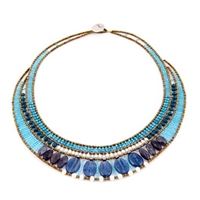this statement Necklace in various shades of Blue is sure to get noticed. Blue Kyanite, Zircon, Apatite & Iolite Gemstones compliment each other. Accented with White Water Pearls and Murano Glass Seed Beads on Stainless Steel wire. Made in Italy by Ziio