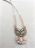 this statement Pendant Necklace in various shades of Pink is sure to get noticed.Pink Morgainite, Zircon & Moonstone Gemstones compliment each other. Accented with White Water Pearls and Murano Glass Seed Beads on Stainless Steel wire. Made in Italy