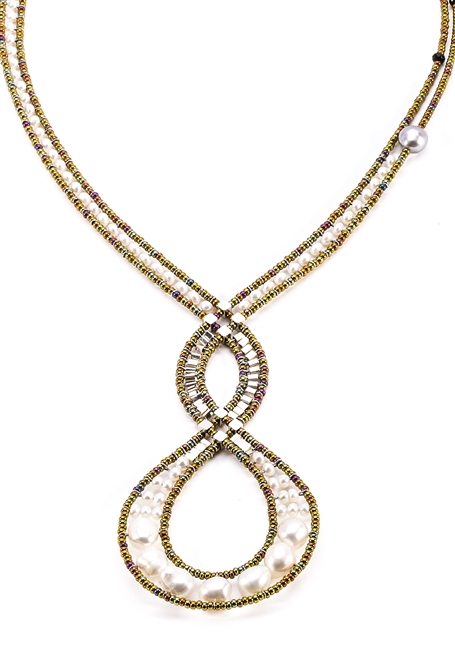 Ziio's Infinity Necklace features an open, Intertwining design & asymmetrical neck band. This one is done in White Water Pearls with Black Tourmaline & Silver Beads as accents. Beaded on stainless steel wire with Murano Glass seed Beads. Made in Italy