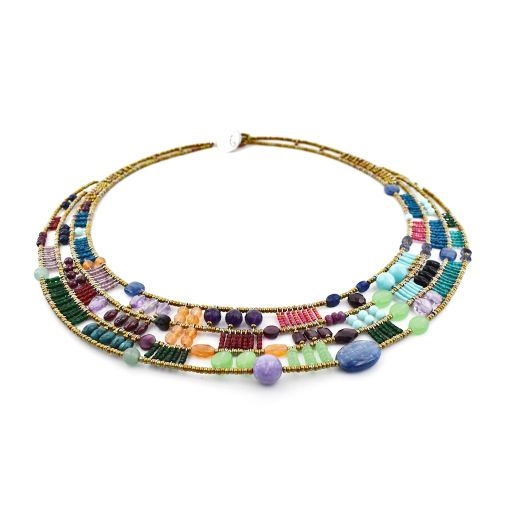 "The ""Cici"" Bib Necklace by Ziio is a masterpiece of rich multi-colored Gemstones. Purple Amazonite & Amethyst, Green Chrysophrase, Red Garnet, Blue Kyanite, Iolite, Lapis & Agate, Orange Carnelian - beautifully blended together and accented"