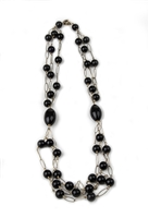 "A beautiful, long, Black Onyx Bead Necklace in Rose Gold plated 925 Sterling Silver. Three strands of round Onyx Beads (aprox. 12mm) on an open link chain are connected on both sides by a large cylindrical Black Onyx Bead (aprox 1 1/4"" L). Length 28"""