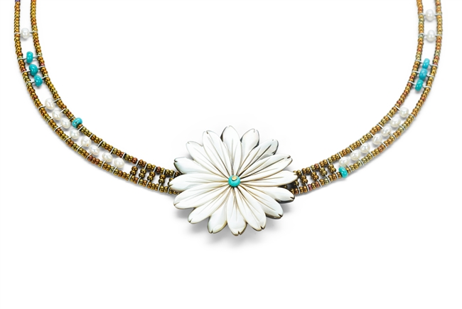 "Hand cut Mother of Pearl Flower is the focus of Necklace by Ziio. Accented with Turquoise Beads & White Seed Pearls framed by Murano Glass Beads. Sterling Silver Button Closure, adjustable length 16"" to 19"". Flower 2""diameter. Hand crafted in Italy"