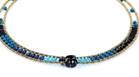 Ziio's thin Giro Necklace in various hues of Blue Gemstones - Lapis, Iolite, Blue Zircon & Black Tourmaline. A great beaded piece to add a subtle touch of color. Hand crafted in Italy on Stainless Steel wire with Murano Glass Seed Beads