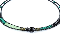 Ziio's thin Giro Necklace in various hues of Green Gemstones - Malachite, Chrysoprase, Green Zircon & Black Tourmaline. A great beaded piece to add a subtle touch of color. Hand crafted in Italy on Stainless Steel wire with Murano Glass Seed Beads.