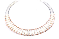 This Mother of Pearl Necklace is an Italian twist on your classic Pearl Necklace. Hand crafted in Italy by Ziio, it features a graduating band of polished, White Mother of Pearl beads, accented with soft pink Coral Beads. On stainless steel wire
