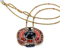 From Ziio's Twilight Collection. This striking Pendant Necklace has a Black Onyx Gemstone at the center, surround by multi-shades of Red & Black Gemstones. Garnet, Coral, Carnelian, Zircon, Tourmaline, Brass & Murano Glass Beads. Hand crafted in Italy.
