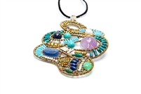 This striking, Limited Edition Pendant Necklace, called Mamba, features Blue Lapis, Kyanite & Turquoise Gemstones accented with a large Amethyst Gemstone bead and a White Pearl. Hand crafted on stainless steel wire with Golden Brass & Murano Glass Beads.
