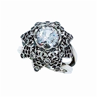 From Brenda Smith's Lace Collection, this ring is done in Rhodium Sterling Silver with White Sapphire Gemstone at the center & as accents. 2.28ctw White Sapphires. Size 7. Can be re-sized.