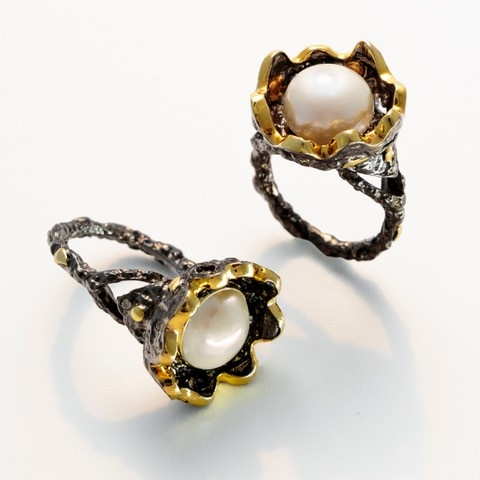 From Brenda Smith's Black & Gold Collection - This beautiful Pearl ring is sure to get attention. Crafted in Oxidized/Blackened Sterling Silver with 18k Yellow Gold accents nesting an 11.5mm White Pearl. White Diamond accents of 0.34ctw. Size 7
