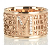 "The collection TUAM is the next iteration of ORIGINE, with the Ave Maria Latin text written in relief over four lines. This Ring in 18kt Rose Gold is embellished by brilliant Diamonds concentrated on the ""M"". Made in Italy"