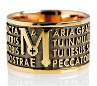 "The Tuam collection by Tuum is the Sterling Silver rhodium plated version of their ring creations. This is the ""Mater"" with the Ave Maria (Hail Mary) Latin text written in over four lines. Crafted in 925 Sterling silver with a bronzed finish"