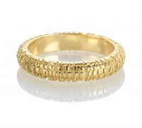 "LA FEDE is a unique, finely detailed eternity Ring or Wedding Band obtained through a unique casting process. What at first looks like a decoration, is actually a perfect micro-sculpture with the Latin ""Pater Noster"" (Lords Prayer) words written on it"