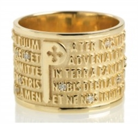 "Ring features the ""Pater Noster"" (Lords Prayer) latin text in relief. The design is unique in that the five lines of the text frame the iconic ""P"". in 18k Yellow Gold with a brilliant diamond positioned manually in each ""O"" throughout the text"