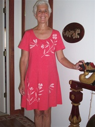 Red playdress with flowers and dragonflies