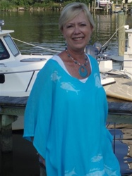 Turquoise rayon poncho with fishes