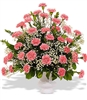 Carnations* in white urn