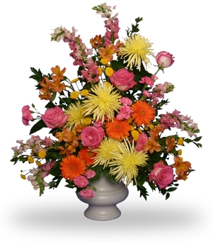Vibrant, colorful mixture in large white urn.