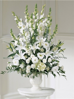 White flowers in white urn
