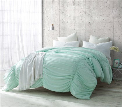 College Twin XL comforter with rippled wave details in soft mint color
