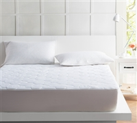 the standard quilted queen mattress pad