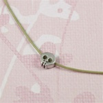 Gray Silk Cord Silver Skull Necklace