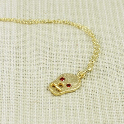 Hammered Gold Red Stone Skull Necklace