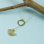 Gold Ring and Bird Charm Necklace
