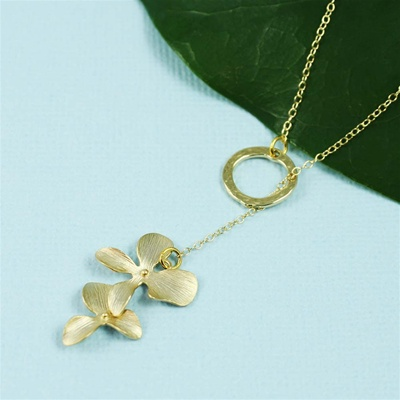 Gold Ring and Orchid Charm Necklace
