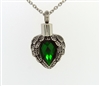 Angel Wings Wrapped Around Emerald Colored Stone