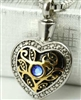 Gold and Silver Heart With Blue Stone