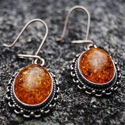 Amber earrings set in sterling silver with a vintage look.