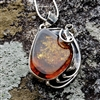 Ornate Amber & Silver Pendant with Contemporary Leaf Design