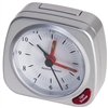 Mini Travel Alarm Clock. This compact alarm clock has a luminous dial, spot light, 5 minute snooze button. Perfect for travelling and holidays. Requires one AA battery - not included.
