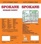 Detailed city map showing highways, street names, recreation trails, informative icons such as schools and parks etc.  A Spokane County map and Spokane and Vicinity map  is included.  Also several insets of districts within the county are shown.