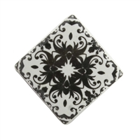 Square black and white ceramic cabinet knob with a floral motif.