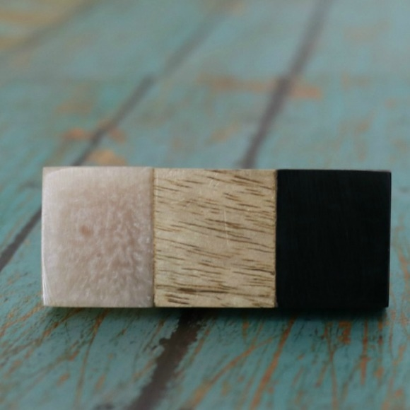 This rectangular cabinet knob is made of resin and wood. The three ...