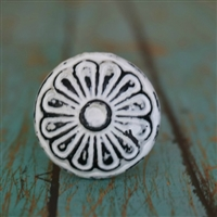 Round Metal Cabinet Knob With Floral Pattern in Distressed White