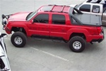 N-Fab's Wheel-to-Wheel Nerf Steps for '02-'06 Chevy/GMC Avalanche With Cladding Short Bed