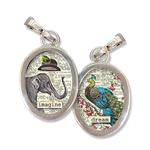 This two sided, charm has the word Imagine on the front with an elephant in a top hat illustration